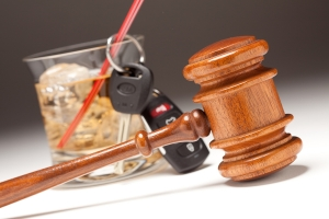 Gavel Alcoholic Drink & Car Keys on a Gradated Background - Drinking and Driving Concept.